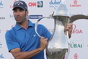 Alvaro Quiros of Spain poses after winning the 2011 Dubai Desert Classic for his fifth European Tour title.