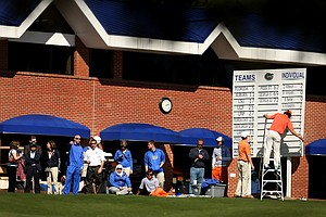 Spectators watch as final-round play nears the end. Florida Gators held on to win the event by nine shots.