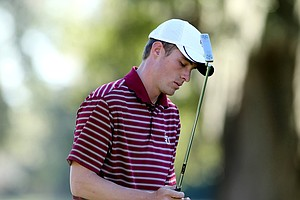 FSU's Drew Kittleson reacts after missing his putt during a playoff or the individual title.