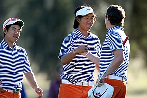 Florida's Phillip Choi, center, and Bank Vongvanij, left, congratulate individual winner Andres Echavarria after he won a playoff during the final round.
