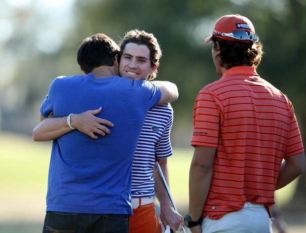 Florida's Andres Echavarria is congratulated by friends and teammates after prevailing in a four-way playoff to win the SunTrust Gator Invitational.