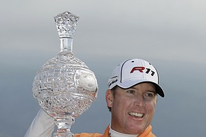 D.A. Points holds up his trophy after winning the AT&T Pebble Beach National Pro-Am in Pebble Beach, Calif., Feb. 13, 2011. Points won after shooting a 5-under par 67 to finish 15-under par.
