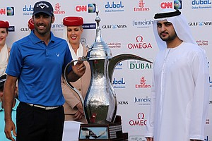 Mohammed bin Rashid al-Maktoum, Dubai's deputy ruler, right, poses with Spain's golfer Alvaro Quiros, left, after winning the Dubai Desert Classic golf tournament in the Gulf emirate on February 13, 2011.