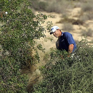 Lee Westwood of England plays his second shot at the par 4, 8th hole during the final round of the 2011 Omega Dubai Desert Classic on the Majilis Course at the Emirates Golf Club on February 13, 2011 in Dubai, United Arab Emirates.