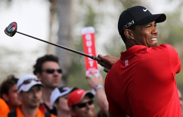 Tiger Woods plays a shot during the last round of the Dubai Desert Classic golf tournament in the Gulf emirate on February 13, 2011. Spain's Alvaro Quiros won the Dubai Desert Classic.