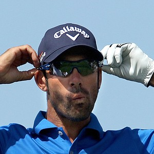 Spanish golfer Alvaro Quiros adjusts his sunglasses before hitting a tee shot during the last round of the Dubai Desert Classic golf tournament in the Gulf emirate on February 13, 2011.
