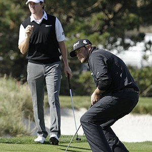 Steve Marino, right, reacts after missing a birdie putt on the fourth green and Jimmy Walker, left, looks on during the final round of the AT&T Pebble Beach National Pro-Am in Pebble Beach, Calif., Feb. 13, 2011. Marino finished tied for fourth after shooting 2-under par 74 to finish total 10-under par.