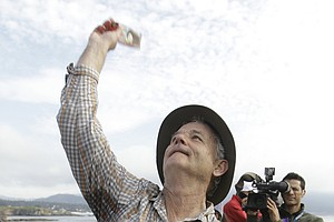 Bill Murray tosses ice cream bars into the gallery on the 18th green at the end of the AT&T Pebble Beach National Pro-Am in Pebble Beach, Calif., Feb. 13, 2011. Murray and D.A. Points won the amateur portion of the championship.