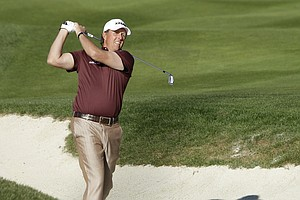 Phil Mickelson follows his shot out of a bunker on the second hole during the final round of the AT&T Pebble Beach National Pro-Am at Pebble Beach Calif., Feb. 13, 2011.