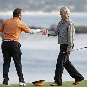 D.A. Points, left, s greeted by his playing partner Bill Murray, right, on the 18th green during the final round of the AT&T Pebble Beach Pro-Am in Pebble Beach, Calif., Feb. 13, 2011. Points won the tournament after shooting 5-under par 67 to finish the tournament 15-under par.