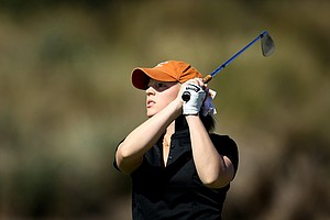 Madisson Pressel of Texas watches her tee shot at the par 3, No. 6. Pressel shot a second round 73 and is T14.