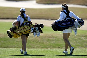 Ashleigh Albrecht of Kentucky and Teresa Puga of Minnesota walk down the fairway during the second round. Kentucky is in 4th place and Minnesota is in 5 th place after Round 2.