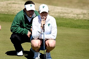 Tulane head coach John Thomas Horton with Meghan Chapman look over her putt at No. 5.
