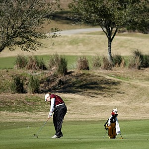 University of Minnesota's Mary Narzisi hits a shot at No. 14. Minnesota improved from fifth place to third in the final round.