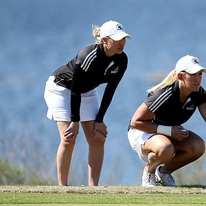 Coastal Carolina's head coach Katie Quinney, left, with Kaitlin Higginbotham  at No. 14. Coastal Carolina won by one stroke.