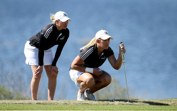 Coastal Carolina's head coach Katie Quinney, left, with Kaitlin Higginbotham  at No. 14. Coastal Carolina won by one stroke.