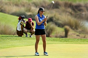 Kentucky's Ashleigh Albrecht, reacts to making a par putt on the second playoff hole, resulting in a tie, during the final round.