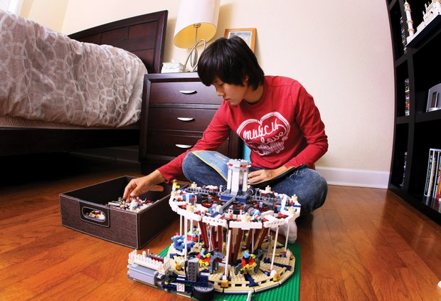 Kim escapes from golf by piecing together a Lego carousel.