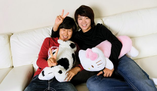 Song-Hee Kim (left) and Na Yeon Choi take it easy in Choi's Florida home.