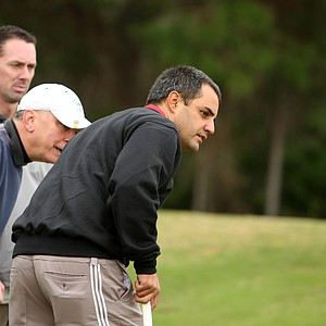 NASCAR driver Juan Pablo Montoya at a recent LPGA International golf outing. Montoya was playing in the 38th annual Daytona 500 NASCAR/Celebrity Charity Golf Classic. His group watches as a putt slowly creeps by the hole.