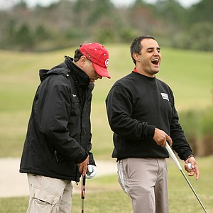 NASCAR driver Juan Pablo Montoya shares a laugh with his personal assistant, Gonzalo Mejia (left), at a recent LPGA International golf outing. Montoya was playing in the 38th annual Daytona 500 NASCAR/Celebrity Charity Golf Classic.