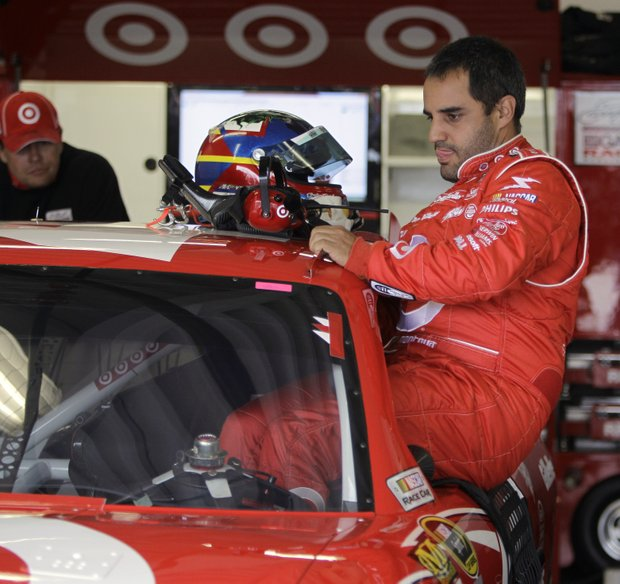 Juan Pablo Montoya is shown in the garage area during practice for Sunday's NASCAR Daytona 500 auto race at Daytona International Speedway in Daytona Beach, Fla., Wednesday, Feb. 16, 2011.