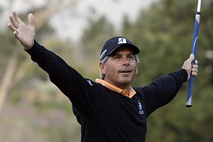 Fred Couples celebrates his nearly 100-foot eagle putt on the first green in the second round of the Northern Trust Open PGA golf tournament in the Pacific Palisades area of Los Angeles Friday, Feb. 18, 2011.
