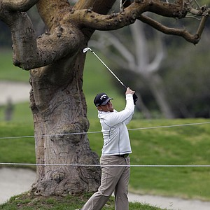 J.B. Holmes hits his approach shot on the ninth hole during the second round of the Northern Trust Open PGA golf tournament in the Pacific Palisades area of Los Angeles Friday, Feb. 18, 2011.
