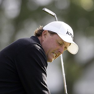 Phil Mickelson reacts after chipping from the rough to the second green in the second round of the Northern Trust Open PGA golf tournament in the Pacific Palisades area of Los Angeles Friday, Feb. 18, 2011.