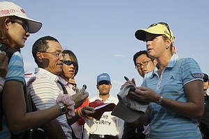 Paula Creamer signs autographs for Thai fans after the second round of LPGA Thailand golf tournament in Pattaya, southern Thailand on Friday, Feb. 18, 2011.