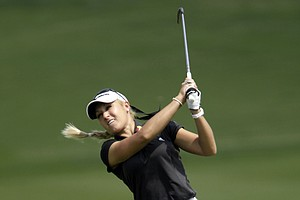 Natalie Gulbis of the U.S. hits the ball from fairway of the 1st hole during the second round of LPGA Thailand golf tournament in Pattaya, southern Thailand Friday, Feb. 18, 2011.