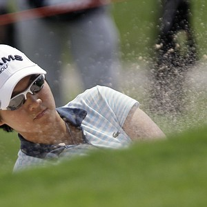 Yani Tseng of Taiwan hits the ball from a bunker of the 1st hole during the second round of LPGA Thailand golf tournament in Pattaya, southern Thailand on Friday, Feb. 18, 2011.