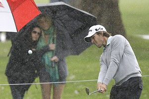 Aaron Baddeley hits to the 11th green as rain falls during the third round of the Northern Trust Open.