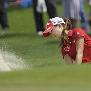 Momoko Ueda of Japan hits the ball from bunker on the 1st hole during the final round of the LPGA Thailand golf tournament in Pattaya, southern Thailand, Sunday, Feb. 20, 2011.