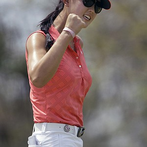 Michelle Wie reacts after a putt on the 1st hole during the final round of the LPGA Thailand golf tournament in Pattaya, southern Thailand, Sunday, Feb. 20, 2011.