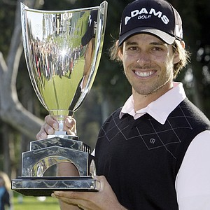 Aaron Baddeley, of Australia, holds the trophy after wining the Northern Trust Open PGA golf tournament at Riviera Country Club in Los Angeles on Sunday, Feb. 20, 2011.