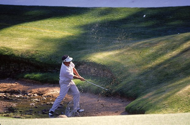 7 Apr 2000: Fred Couples of the USA plays out of Rae's Creek during the second day of the US Masters at Augusta National GC in Georgia, USA.