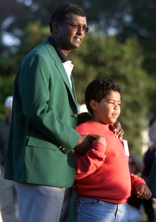 AUGUSTA, : Vijay Singh (L) of Fiji wears his green jacket with his son Qass 09 April, 2000, after winning the Masters at Augusta National Golf Course in Augusta, GA. Singh won the tournament at 10 under par.
