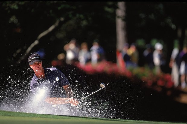 6 Apr 2000: Steve Elkington of Australia hits out of a bunker during the first round of the US Masters at Augusta National in Georgia, USA.