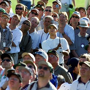 AUGUSTA, : Tiger Woods of the US watches his approach shot from within the crowd on the 18th green 07 April, 2000 during the second round of the 2000 Masters Golf Tournament at Augusta National Golf Club in Augusta, Georgia. Woods finished the day with a round of 72 for a two-day total of three over par.