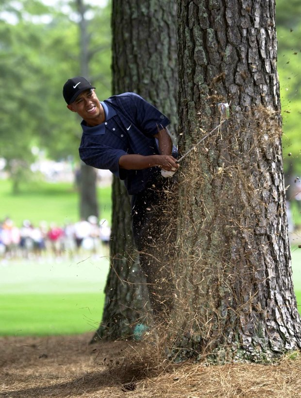 7 Apr 2001: Tiger Woods of the USA plays his second shot from behind a tree on the 3rd hole during the third day of the 2001 Masters at the Augusta National Golf Club, Augusta, GA