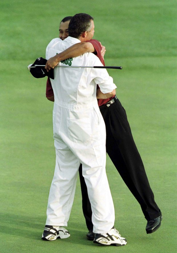 8 Apr 2001: Tiger Woods of the USA celebrates with his Caddie Steve Williams after winning the Masters on the 18th green during the final day of the 2001 Masters at the Augusta National Golf Club, Augusta, Georgia, USA.