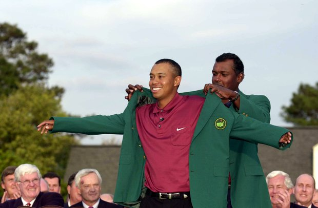 8 Apr 2001: Tiger Woods of the USA is presented with his second green jacket by defending champion Vijay Singh of Fiji after the final day of the 2001 Masters at the Augusta National Golf Club, Augusta, Georgia, USA.