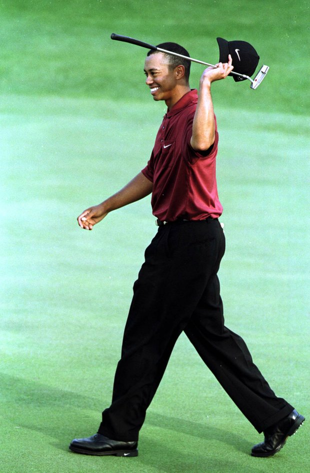 8 Apr 2001: Tiger Woods of the USA celebrates after winning the Masters on the 18th green during the final day of the 2001 Masters at the Augusta National Golf Club, Augusta, GA