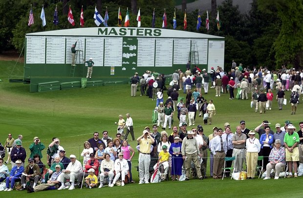 AUGUSTA, : Fans at the 9th green stand in front of the leader board at the Augusta National Golf Club 05 April 2001 during the opening round of the 2001 Masters Golf Tournament in Augusta, Georgia.