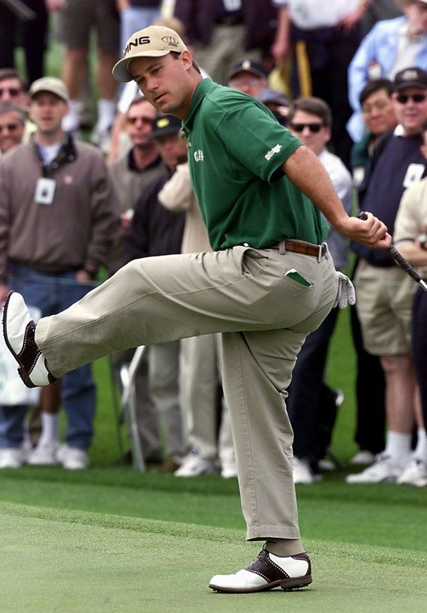 AUGUSTA, : Chris DiMarco of the US reacts to missing a birdie putt on the 18th hole, 05 April 2001, during the opening round of the 2001 Masters Golf Tournament at the Augusta National Golf Club in Augusta, Georgia. DiMarco finished the round at 7 under-par.
