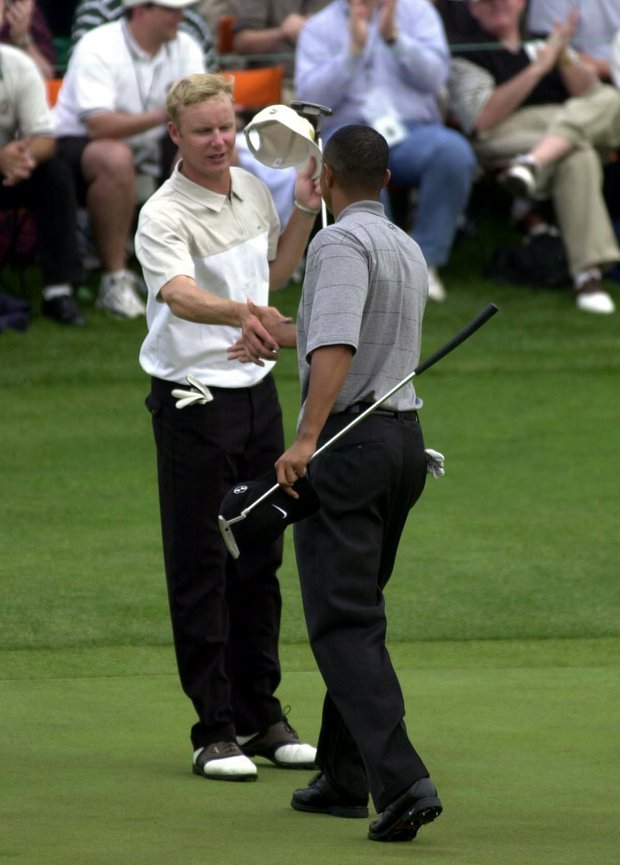 5 Apr 2001: Tiger Woods of the USA shakes hands with Mikko Ilonen of Sweden on the 18th hole after their round during the first day of the Masters at the Augusta National Golf Club, Augusta, Georgia.
