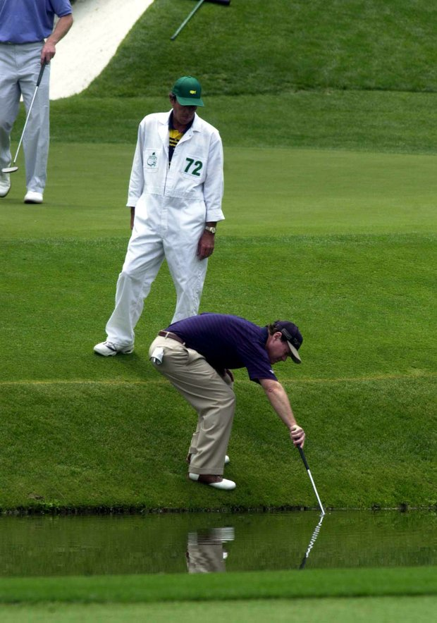 5 Apr 2001: Tom Watson of the USA in the water on the 11th hole during the first day of the 2001 Masters at the Augusta National Golf Club, Augusta, GA