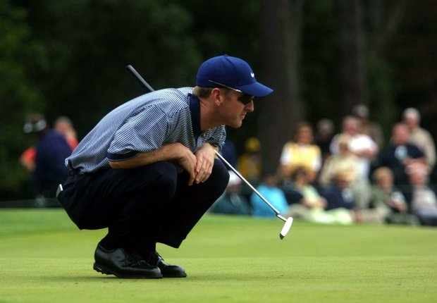 5 Apr 2001: David Duval of the USA lines up a putt on the 2nd hole during the first day of the 2001 Masters at the Augusta National Golf Club, Augusta, GA
