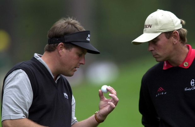 5 Apr 2001: Phil Mickelson of the USA with Thomas Bjorn of Denmark examine the ball on the 2nd hole during the first day of the 2001 Masters at the Augusta National Golf Club, Augusta, GA
